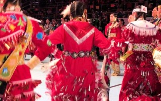Tia Wood Heads a Sea of Red Jingle Dancers 2017 GON Tribute