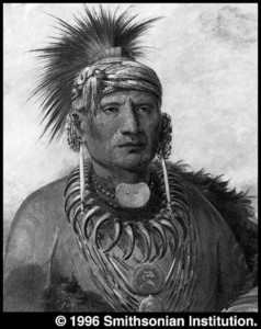Hair pipes worn as ear ornaments. Iowa war chief (1845-46).